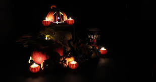 led pumpkin tea lights festive halloween holiday scene lit only with pumpkin candles and
