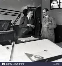 architects drafting table 1950s historical two men have a discussion in an architect u0027s or
