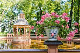 Summer Garden St Petersburg Russia - vase with flowers in the summer garden st petersburg stock photo