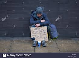 Seeking Manchester Request For Help From Homeless Holding Cardboard Sign
