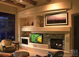 Designing A Media Room - stacked stone media wall design by dagr design