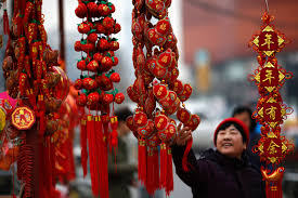 a woman looks at traditional decorations celebrating for chinese