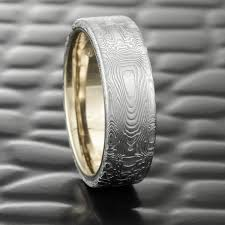damascus steel wedding band damascus steel flat 7mm wide men s wedding band with liner of 14k