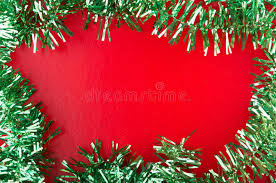 christmas tinsel frame of green christmas tinsel on background stock photo