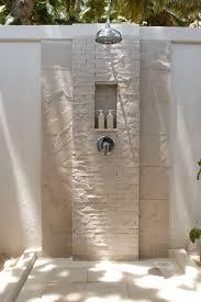 modern tropical outdoor bathroom and bathtub showers