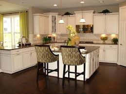 white kitchen cabinets with black island antique white kitchen cabinets with chocolate glaze black island