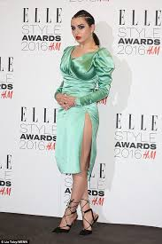 charli xcx wears quirky green satin dress at elle style awards
