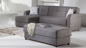 gray suede sectional sleeper sofa with chaise and tufted backrest