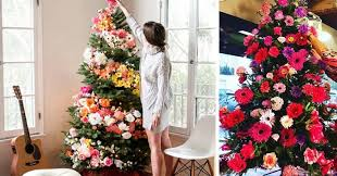 christmas tree decorating are decorating their christmas trees with flowers and the
