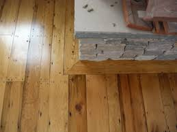 Trim Around Fireplace by Fireplace Frame Scribed To Stone Fireplace Recycled Pine Floors