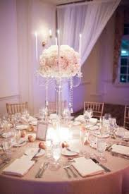 Elegant Centerpieces For Wedding by Tall Silver Candelabra With White Orchids These Are The Flowers