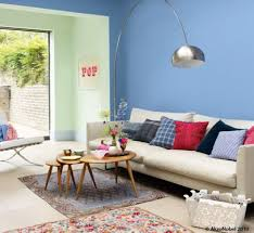 blue wall living room green couch w blue walls for living room we