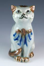 vintage 5 inch ceramic cat figurine with bird painting made in