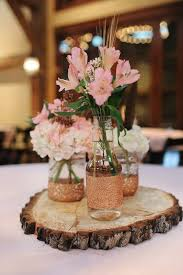 country centerpieces rustic tree stump centerpieces with jars and pink