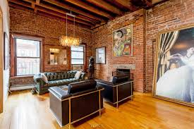 Loft Living Room by A 32 Foot Long Living Room With Exposed Brick Dominates This