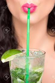 pretty alcoholic drinks closeup of sexual pretty brunette female face of with curly