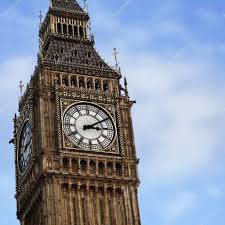 London Clock Tower by Famous London Big Ben Clock Tower On The Blue Sky Background