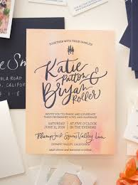 vibrant watercolor crest wedding invitations