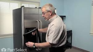 refrigerator repair replacing the ice dispenser door assembly