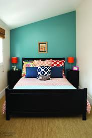small cottage guest bedroom with lots of bright accents pillows