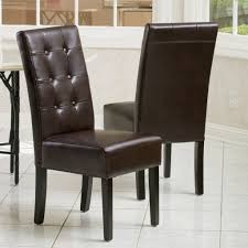 black leather tufted dining room chair with high back and four