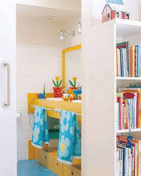 fun colorful bathroom with orange sink vanity also blue floor
