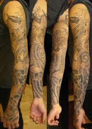 image of bird tattoos black and grey swirly bird wrist tattoo is