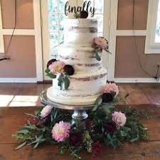 wedding flowers knoxville tn wedding cake with purple flower topper and flower accent