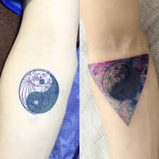 triangle and moon tattoo on the forearm covering up a