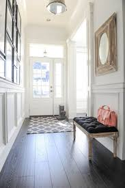jws interiors styling an entry hanging art over a bench