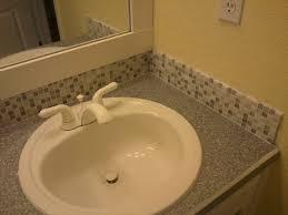 Bathroom Sink Backsplash Ideas Grey Mozaic Tile Backsplash Connected By White Sink And Grey
