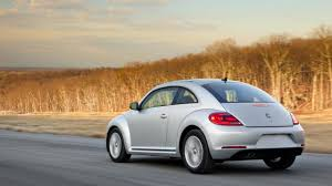 volkswagen bug 2013 bbc autos a tale of two vws jetta hybrid versus beetle tdi