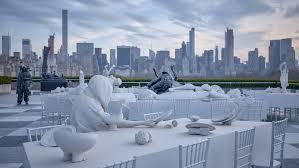 rooftop dinner party installation by villar rojas hekkta