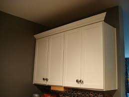 how to add crown molding to kitchen cabinets adding crown molding to kitchen cabinets the small and chic home