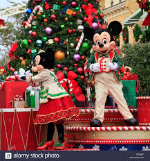 holiday mickey and minnie mouse on christmas parade in magic