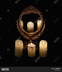 mystic still life with mirror reflection and three burning