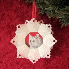 make our tea bag ornament for with fancy paper and a