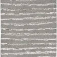 decor grey area rug with dark wood floor for home interior design