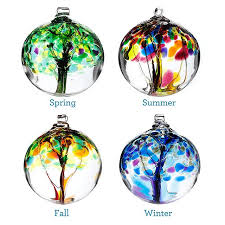 four seasons glass globes winter summer and fall