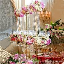 tall and large artificial flower arrangement stand wedding table