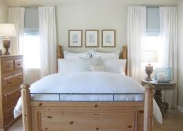 apartment single bed with white bedding and natural bed frame