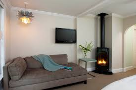 bedroom baseboard as corner fireplace with gas fireplace and