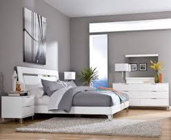 grey wall color scheme and white bedding sets in modern bedroom