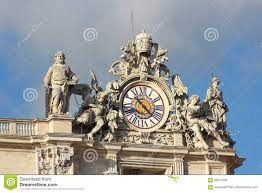 clock with sculptures at saint peter basilica in vatican editorial