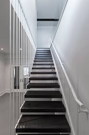 architecture black staircase flooring tile and white wall