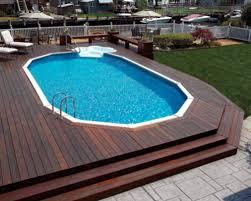 Backyard Flooring Options - pool rails in ground pool steps patio umbrellas wooden fence pool