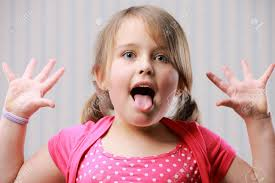 beautiful little making funny face stock photo picture and
