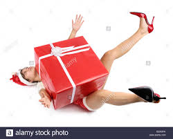 woman pressed down by a large christmas gift box stock photo
