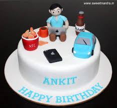 gadgets techie theme customized cake with guy sitting with laptop