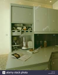 electric food mixer and processor and storage shelves in kitchen
